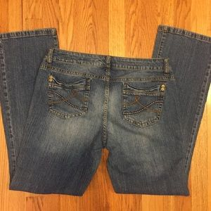 "DKNY Jeans. Boot cut 8 1/2"" (17"") boot opening."